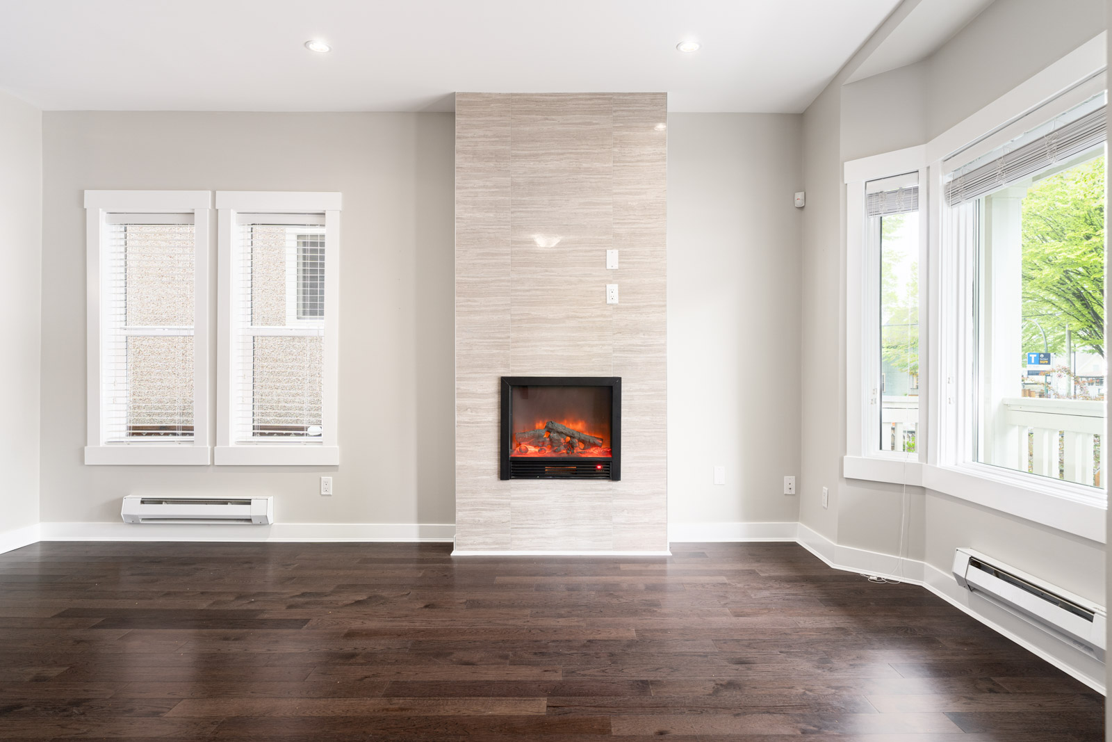 Living Room with dark hardwood floors and an electric fireplace
