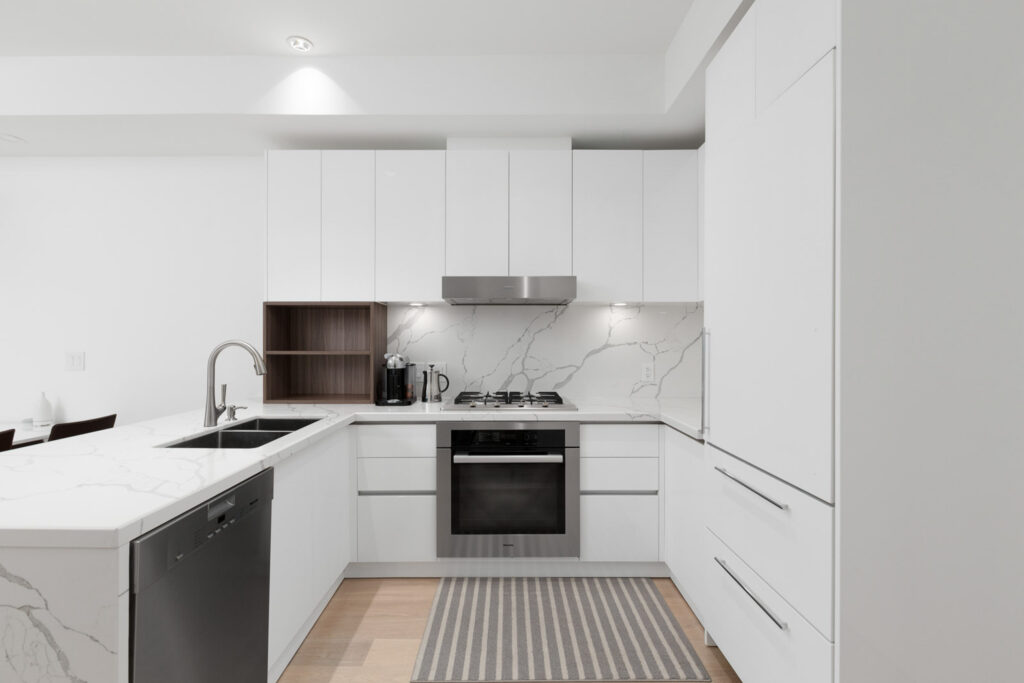 East Van rental home with white cupboards and dark wood accemnt
