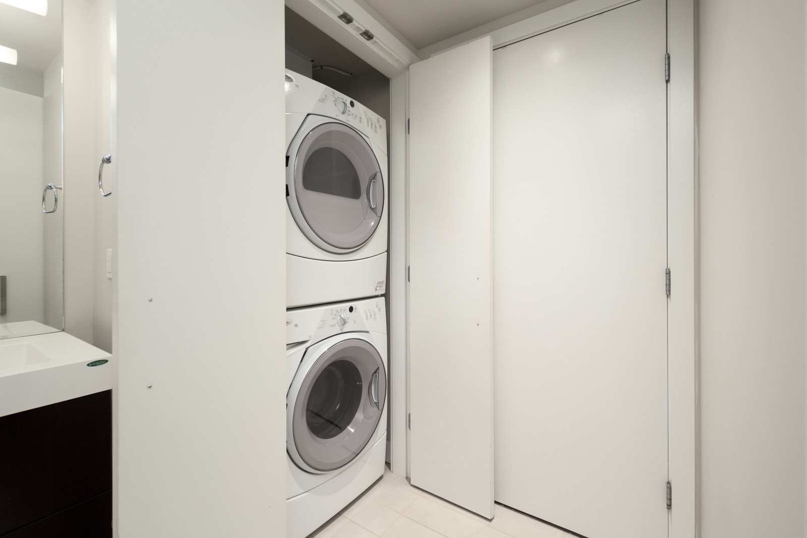 in-suite laundry unit in luxury condo managed by Birds Nest Properties in Downtown Vancouver