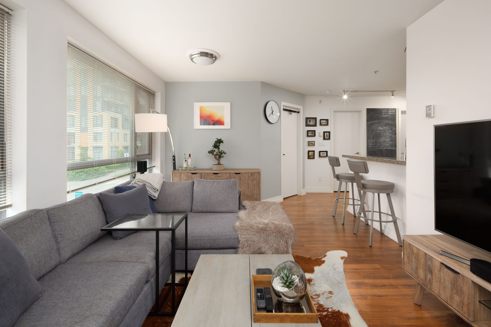living room with laminated floors in rental condo in the West End neighbourhood of Vancouver