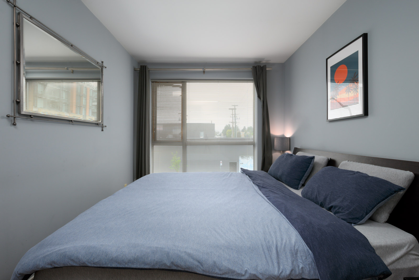 bedroom with closet in rental condo at Arbutus Outlook in the West End neighbourhood of Vancouver