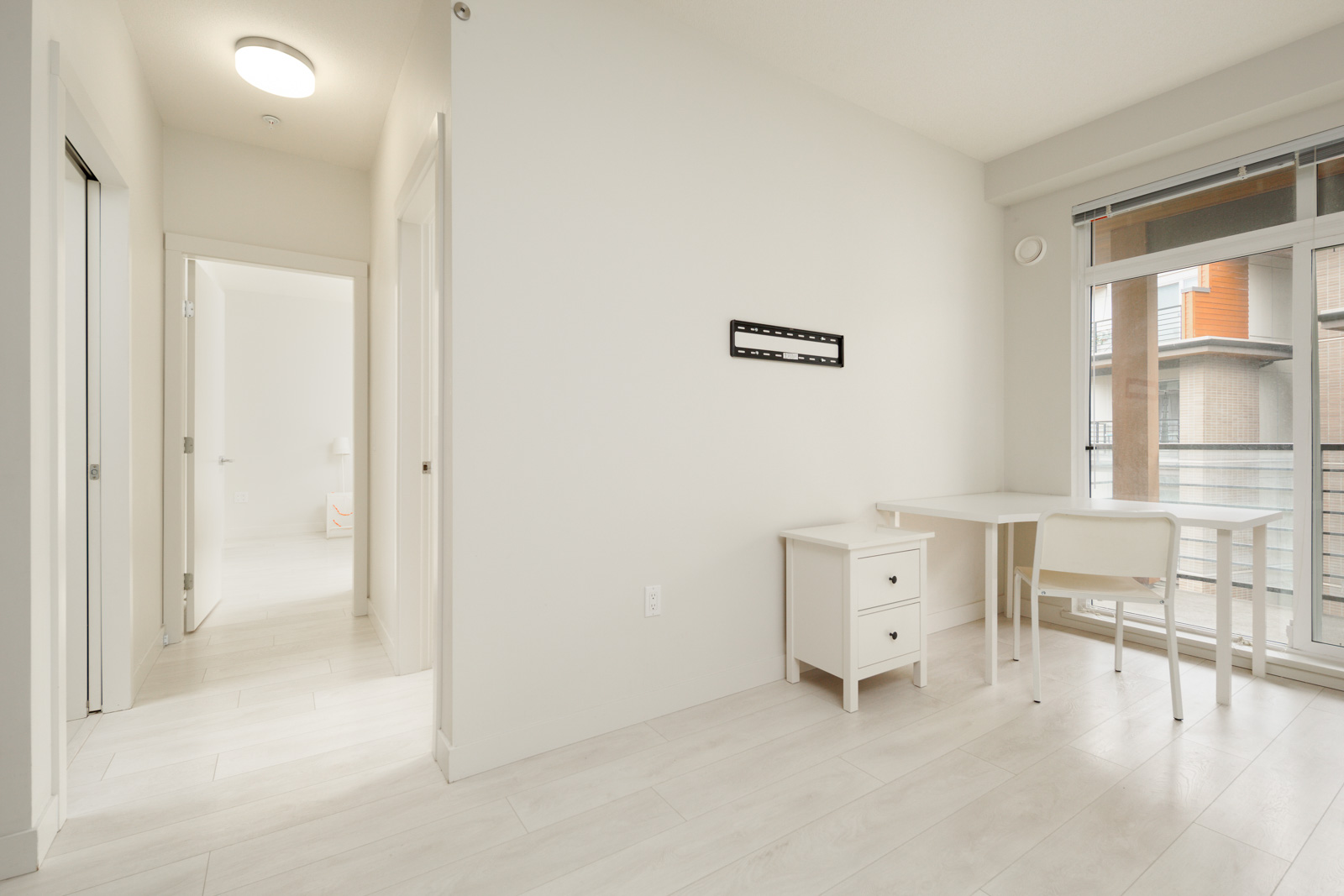 bedroom with white walls and furniture