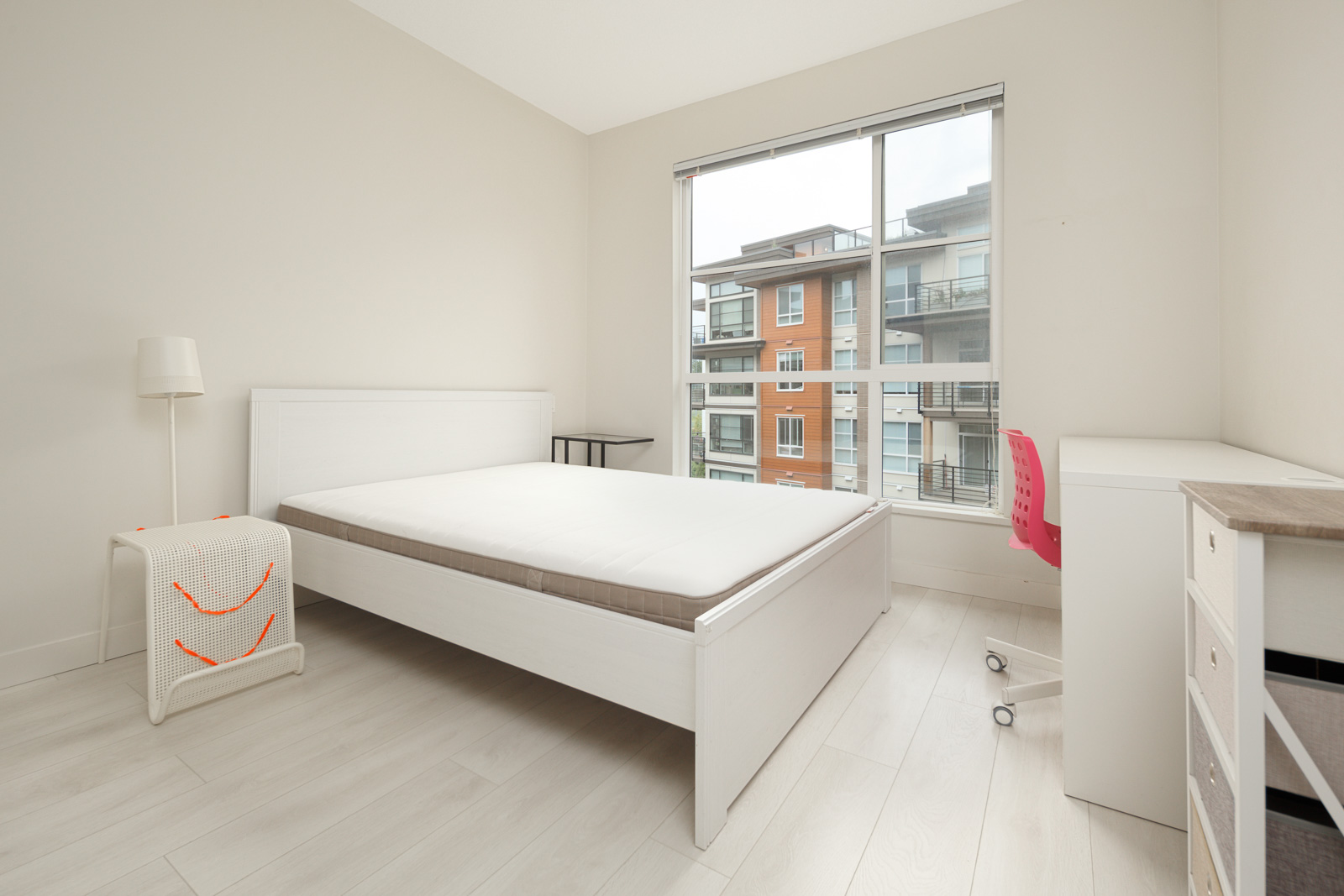 bedroom with white walls and window in rental condo in the Metrotown neighbourhood of UBC