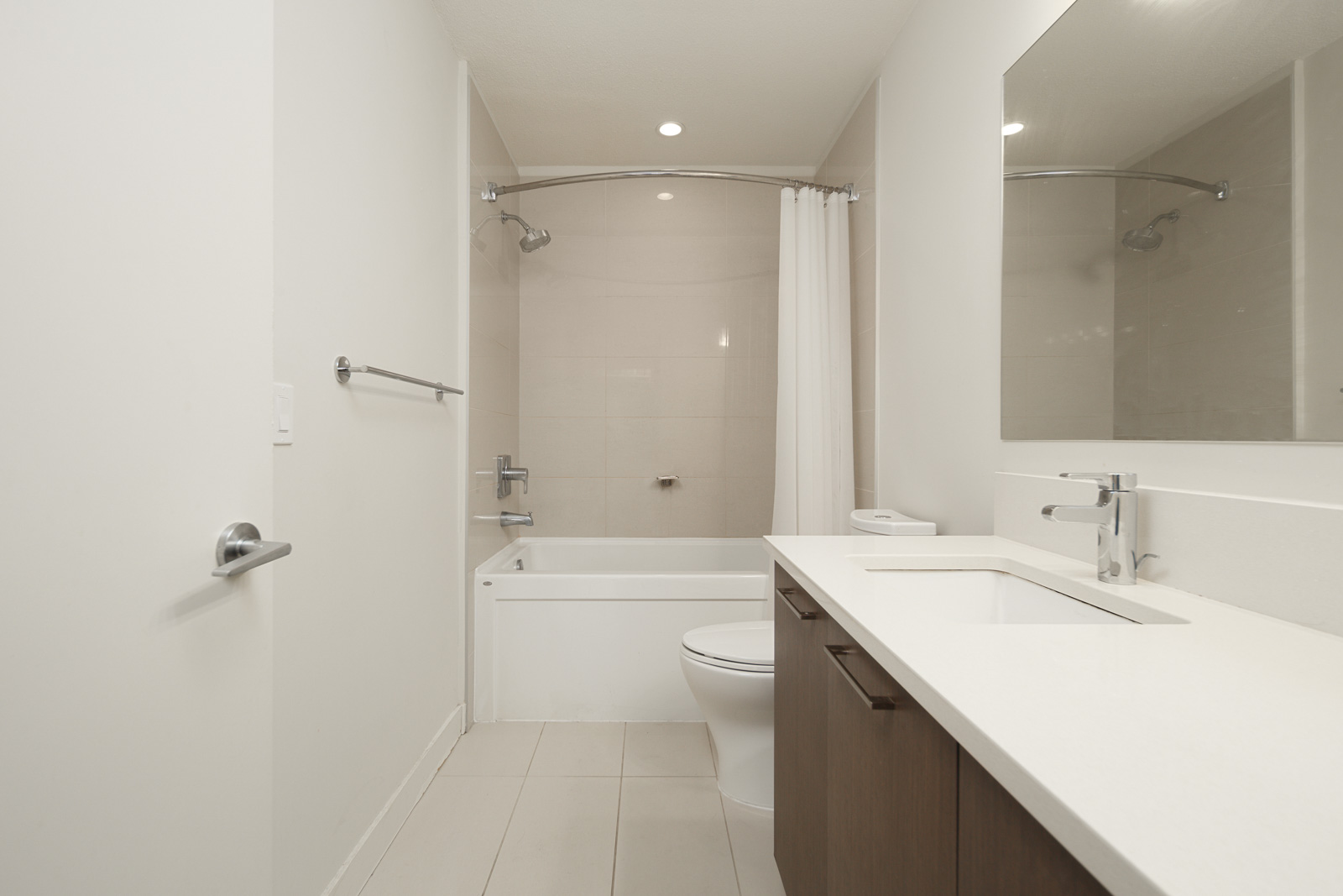 bathroom with tub and white walls