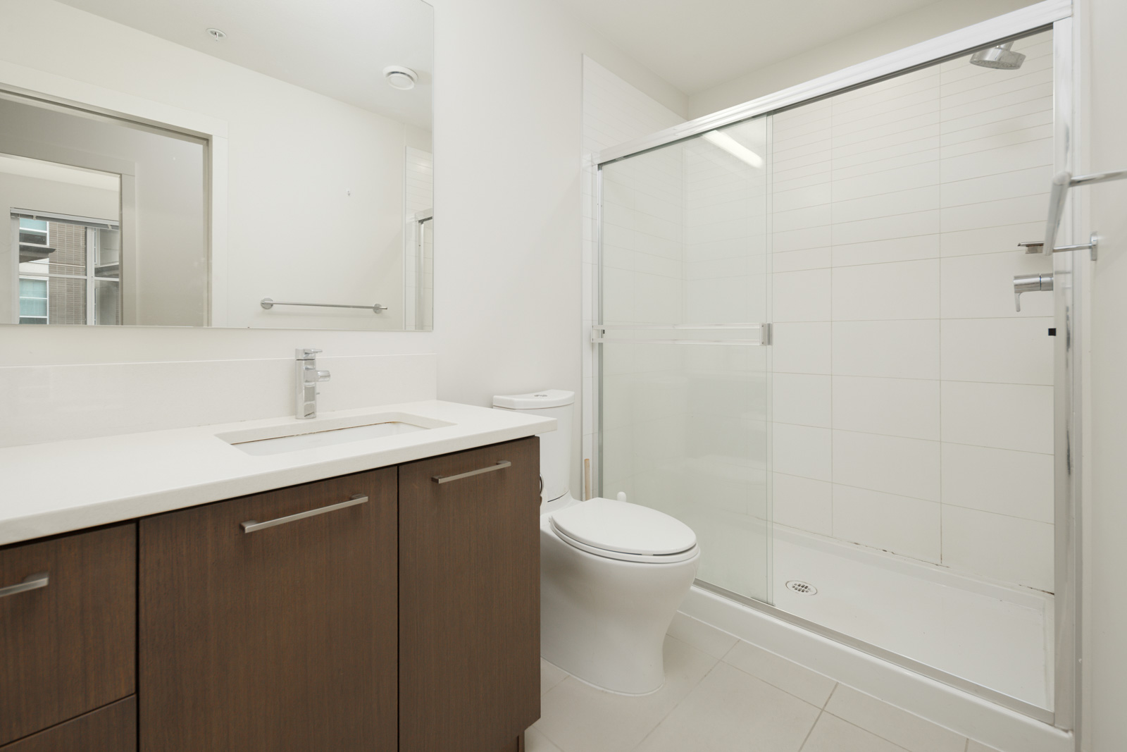 bathroom with mirror and standing shower
