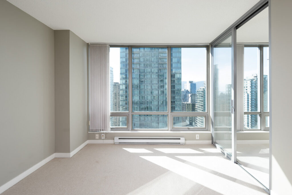 living room, with solarium off the side in apartment coal harbour vancouver