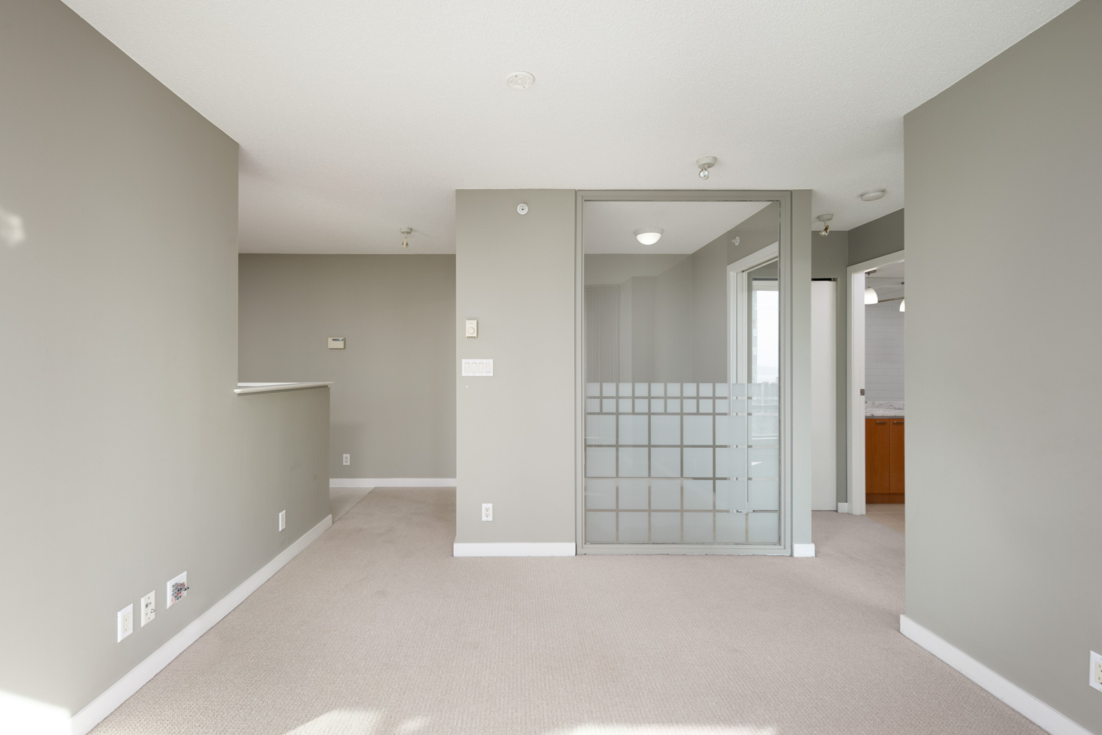 living room with grey walls and flex space in downtown vancouver