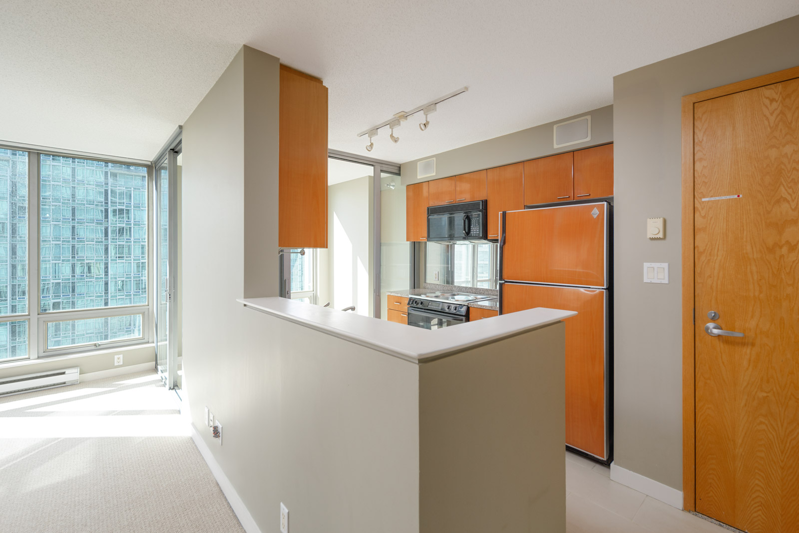 alley kitchen with solarium in condo downtown vancover