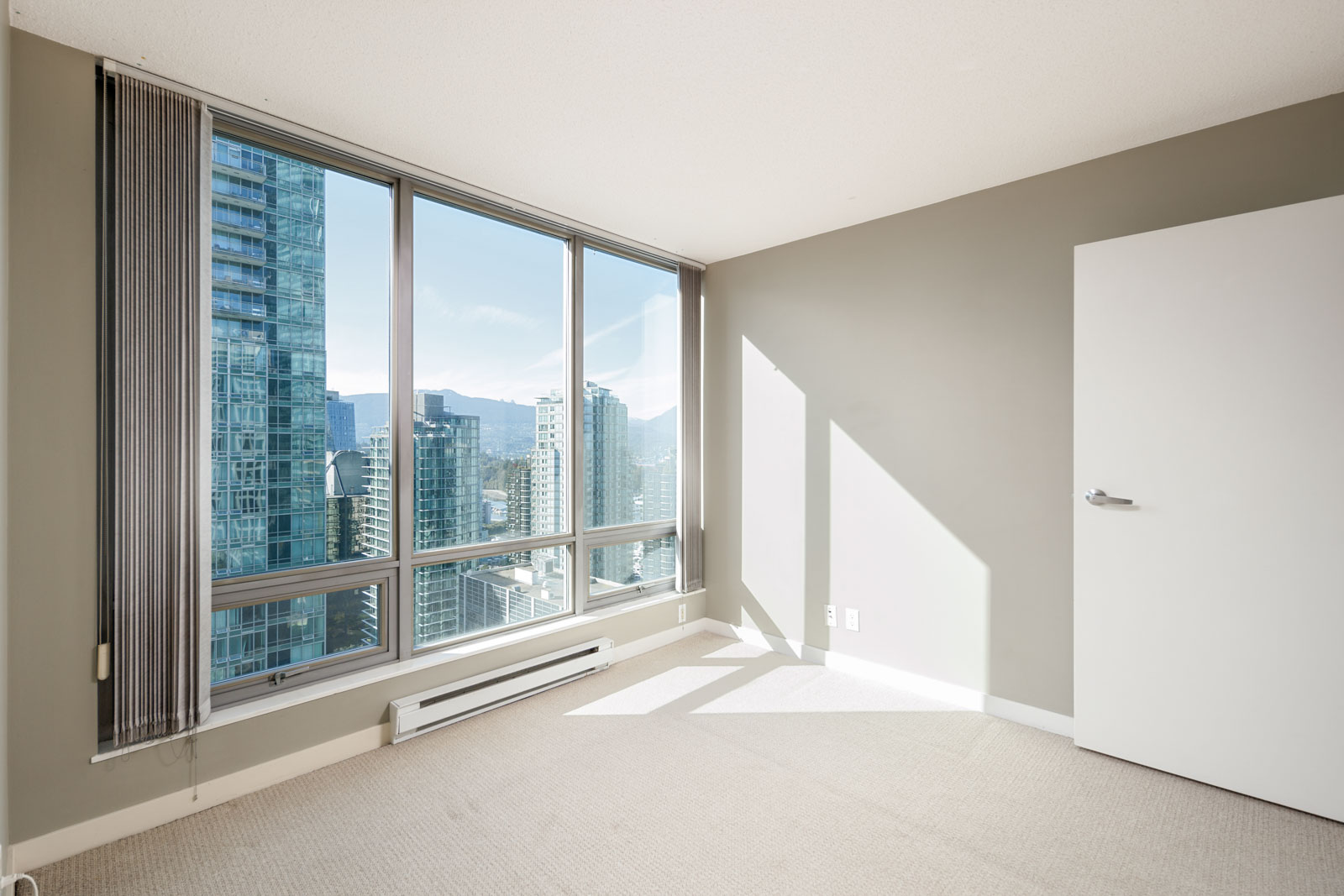 bedroom with city views in downtown vancouver