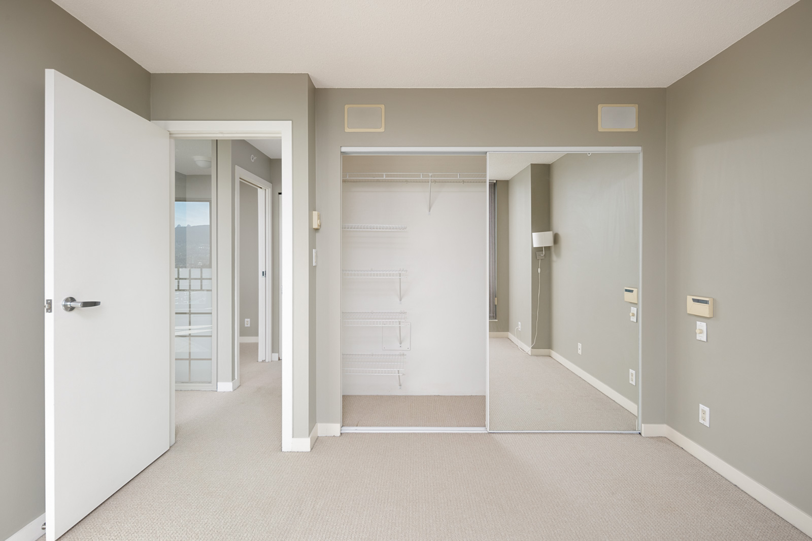 bedroom with grey walls with large closet in vancouver