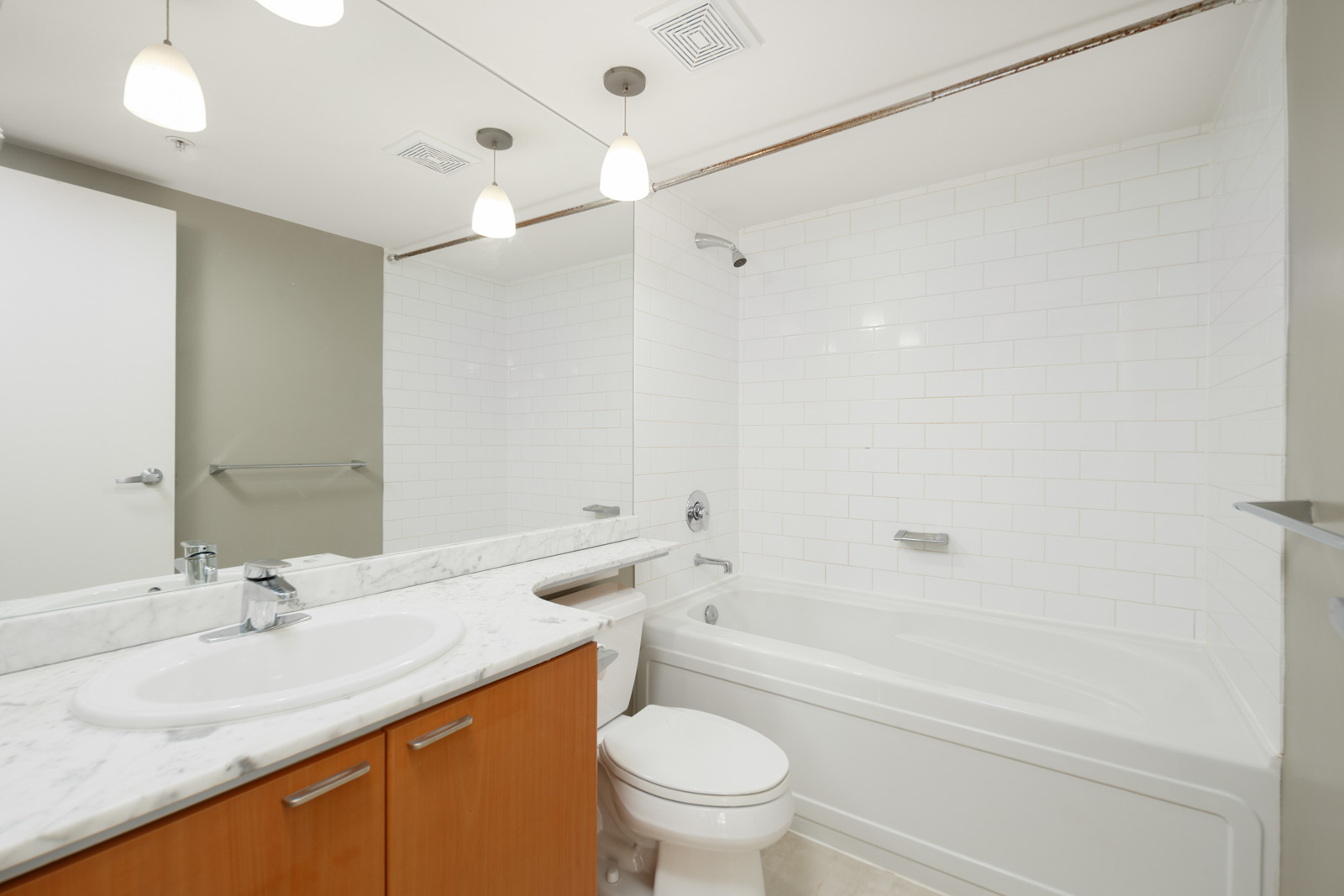 bathroom with full tub in managed by birds nest properties