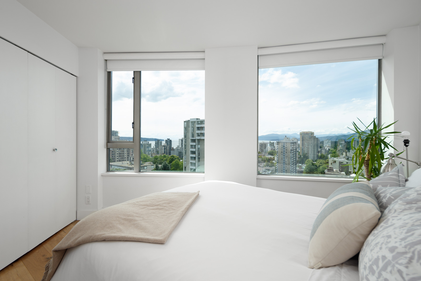 bedroom with white walls and window in rental condo in the West End neighbourhood of Vancouver