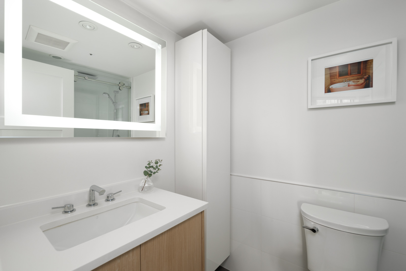 bedroom with white walls and hardwood floors in rental condo in the West End neighbourhood of Vancouver