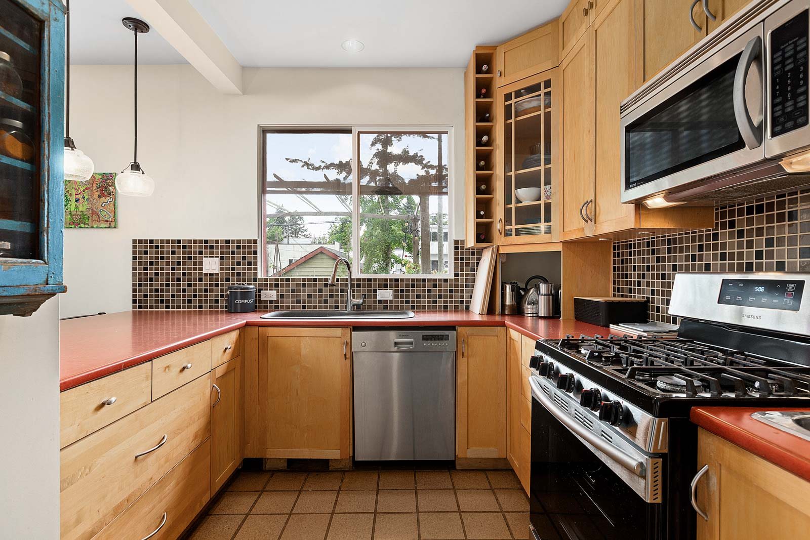 stainless steel appliances overlooking yard in East Vancouver home