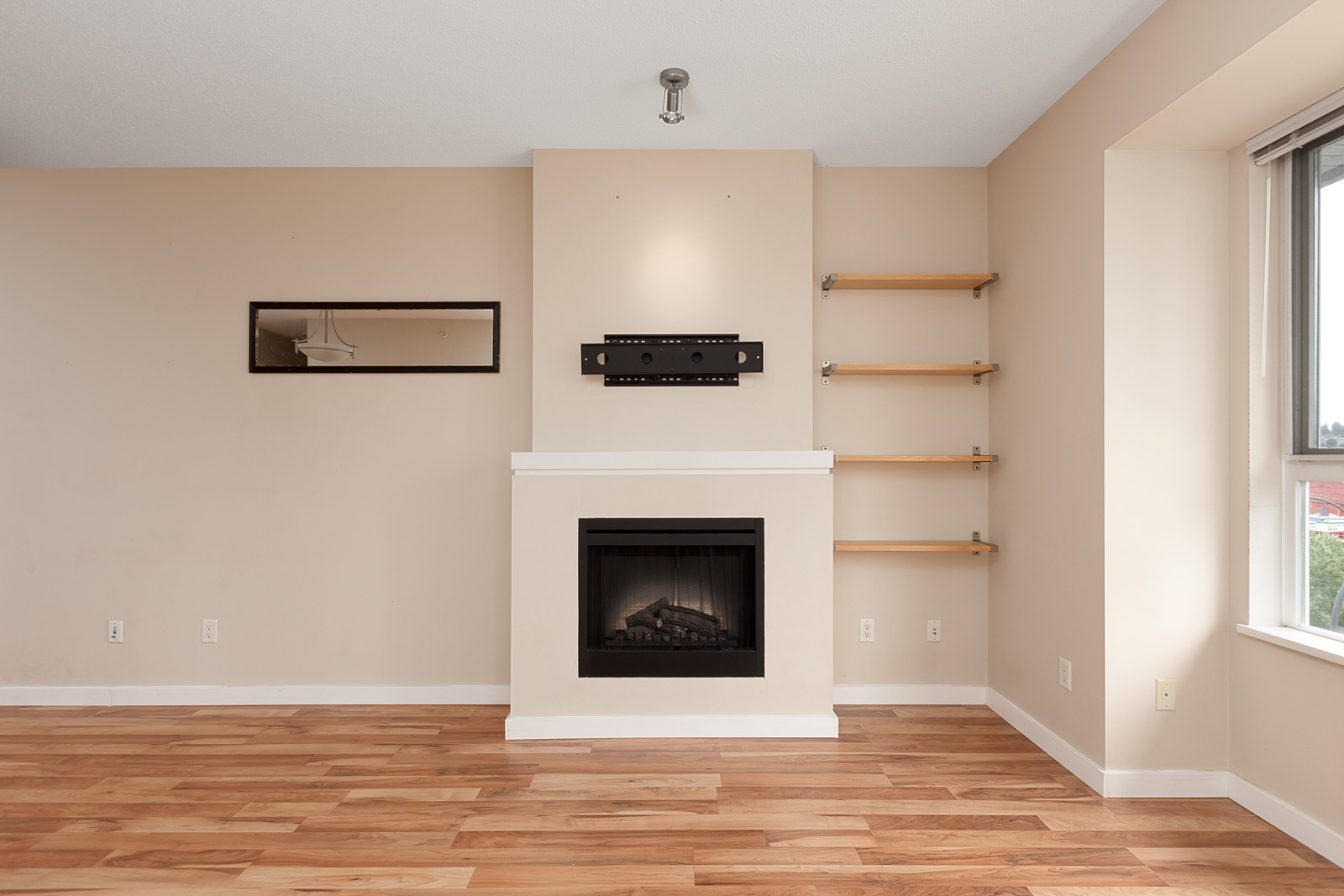 living room with hardwood floors in rental condo in the Brentwood neighbourhood of Burnaby