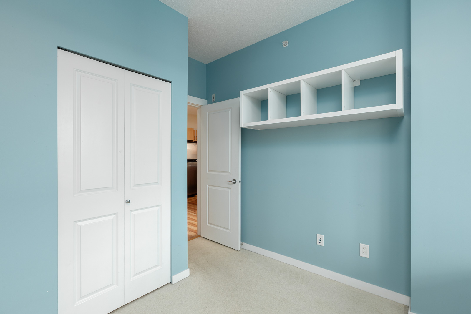 spacious bedroom with blue walls