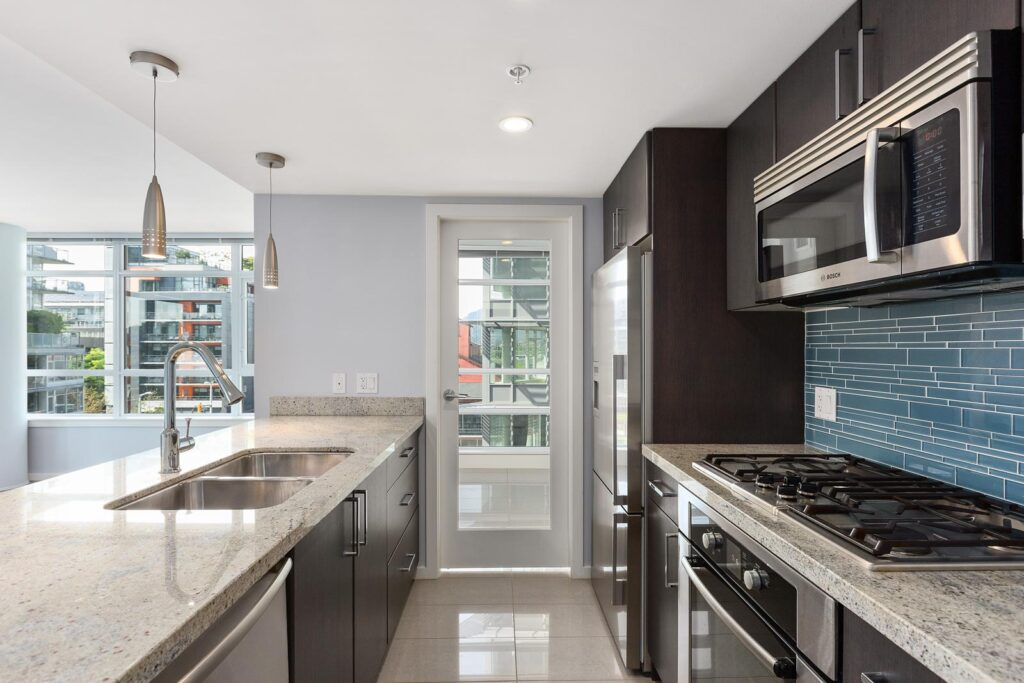 kitchen with stainless steal appliances in upscale condo managed by Birds Nest Properties