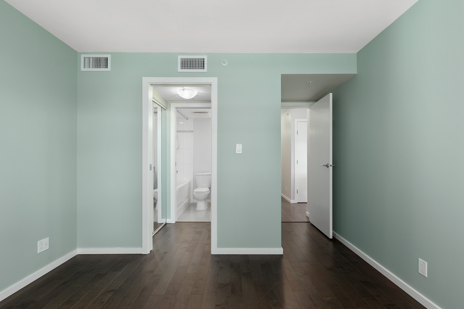 Bedroom with walk in closet and chic teal walls