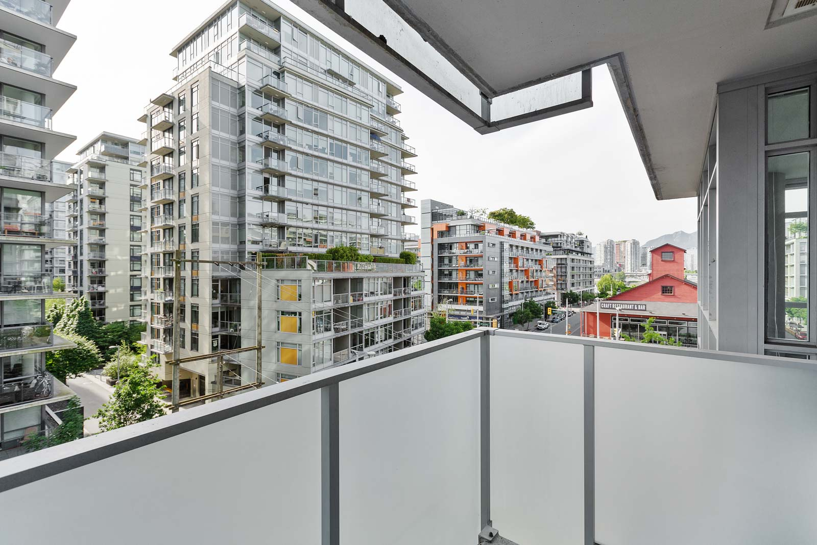 spacious balcony that provides scenic view of the false creek/olympic village neighbourhood