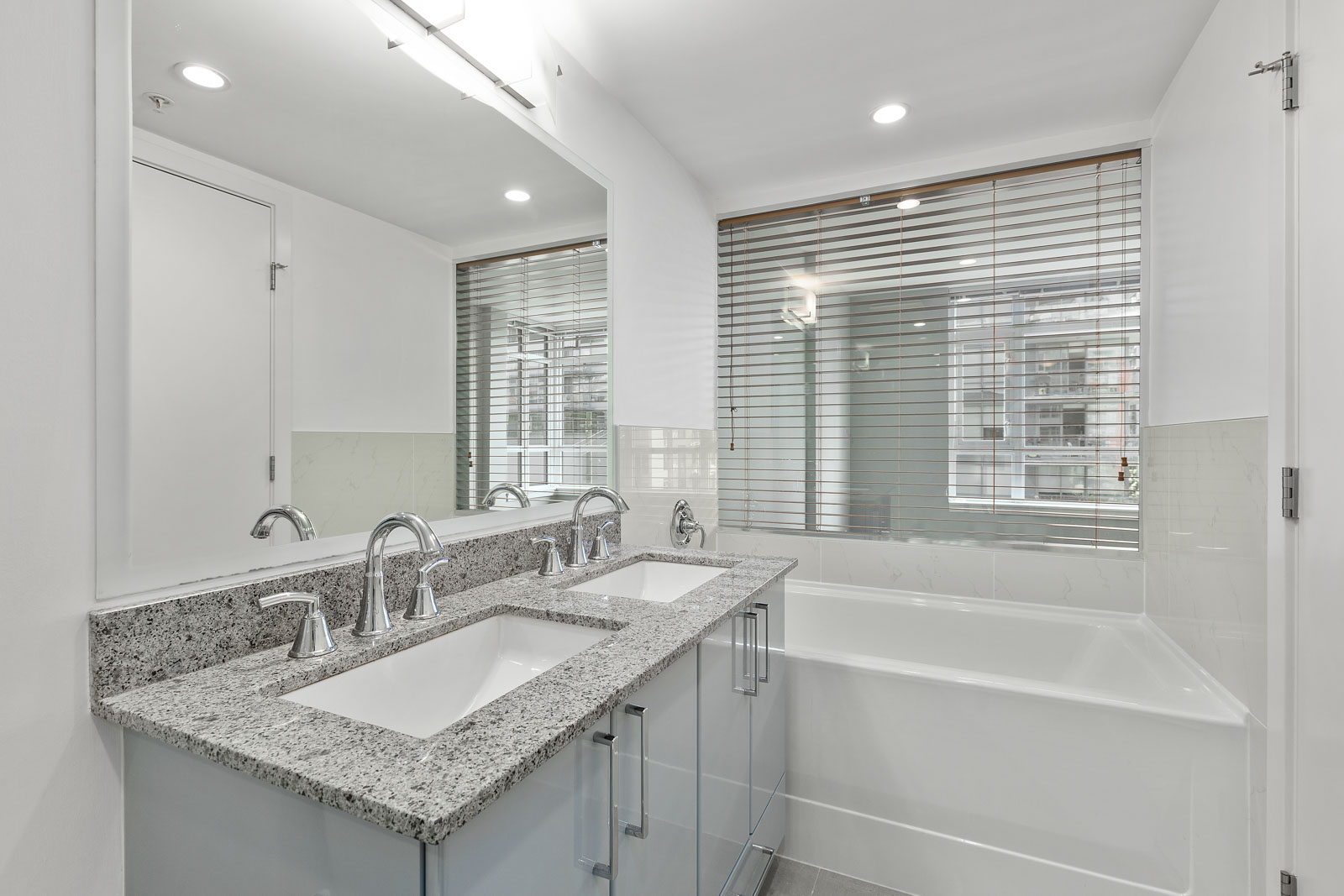 bathroom with tub and huge mirror