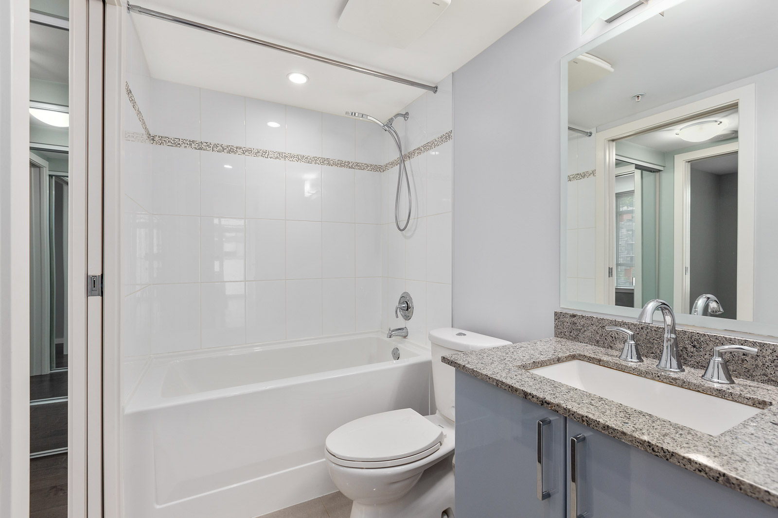 bathroom with white walls and tub