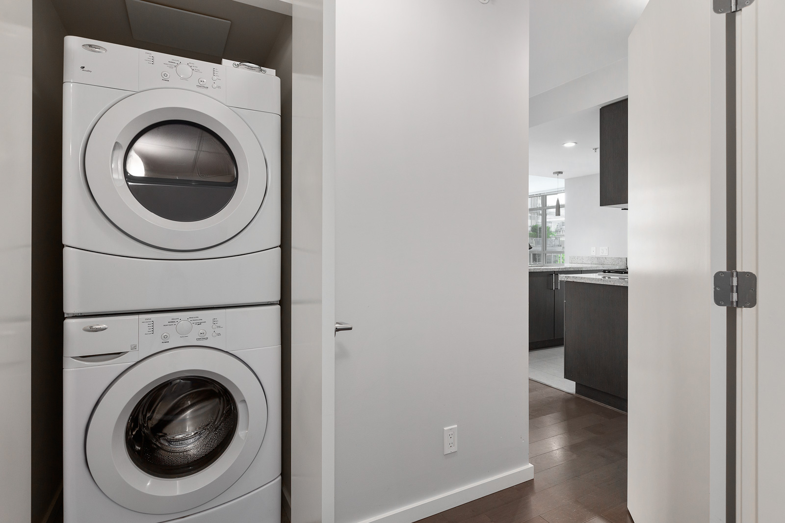 in-suite laundry provided in luxury condo located in false creek/olympic village area