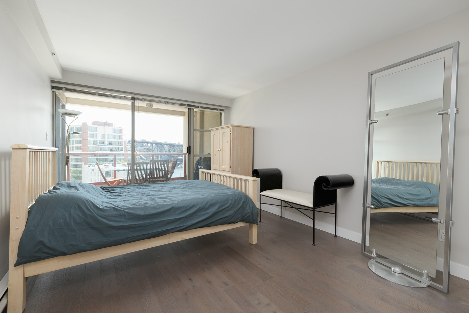 bedroom with waterfront view of the city