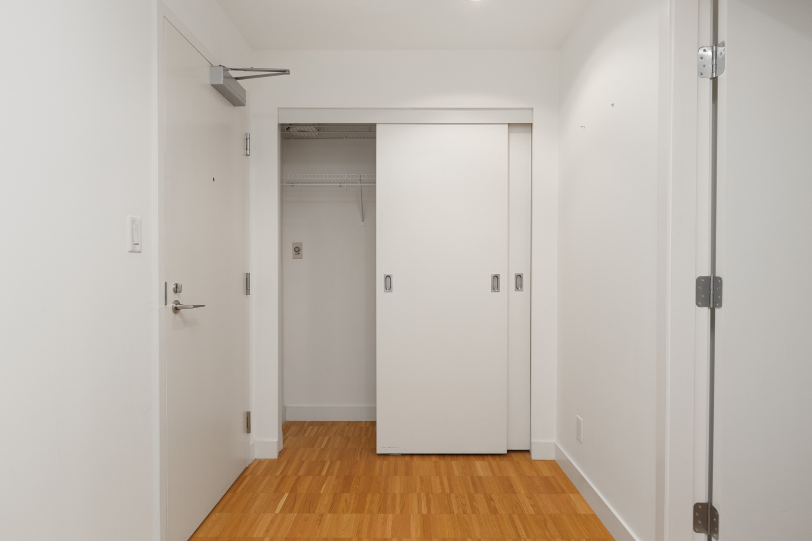 bedroom with walk in closet in luxury condo