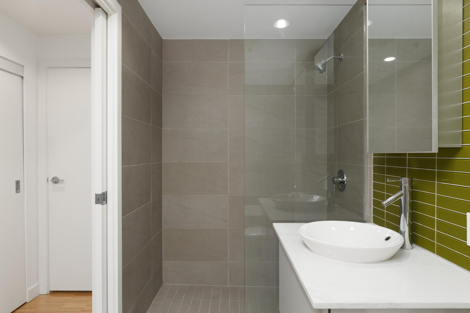 Bathroom with grey walls and huge mirror