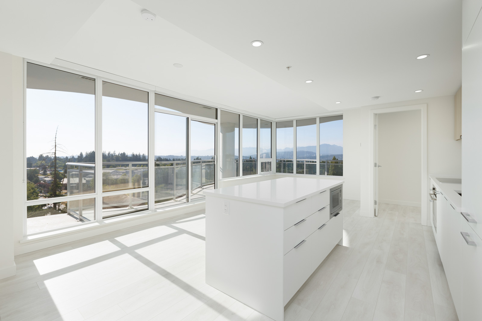 spacious open concept unit with large windows