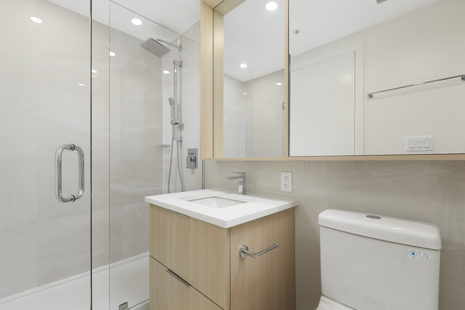 Bathroom with white walls and mirror
