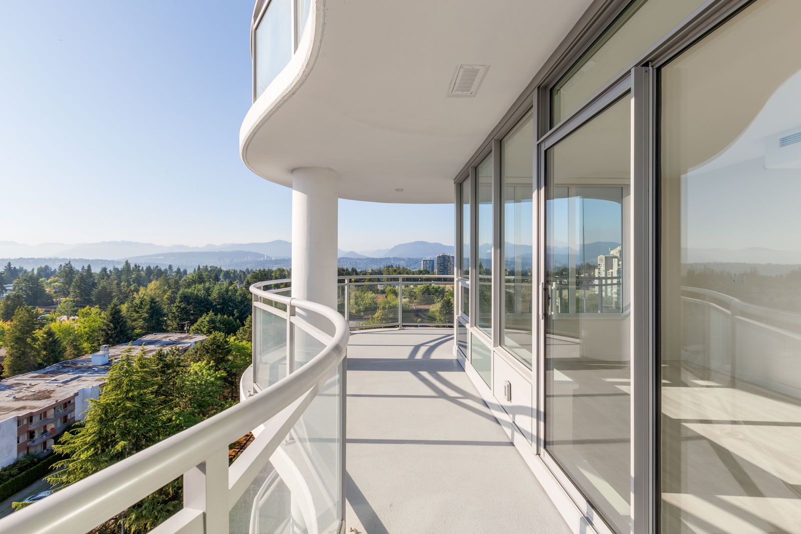 balcony with view of clear skies in rental condo in the Downtown neighbourhood of Surrey