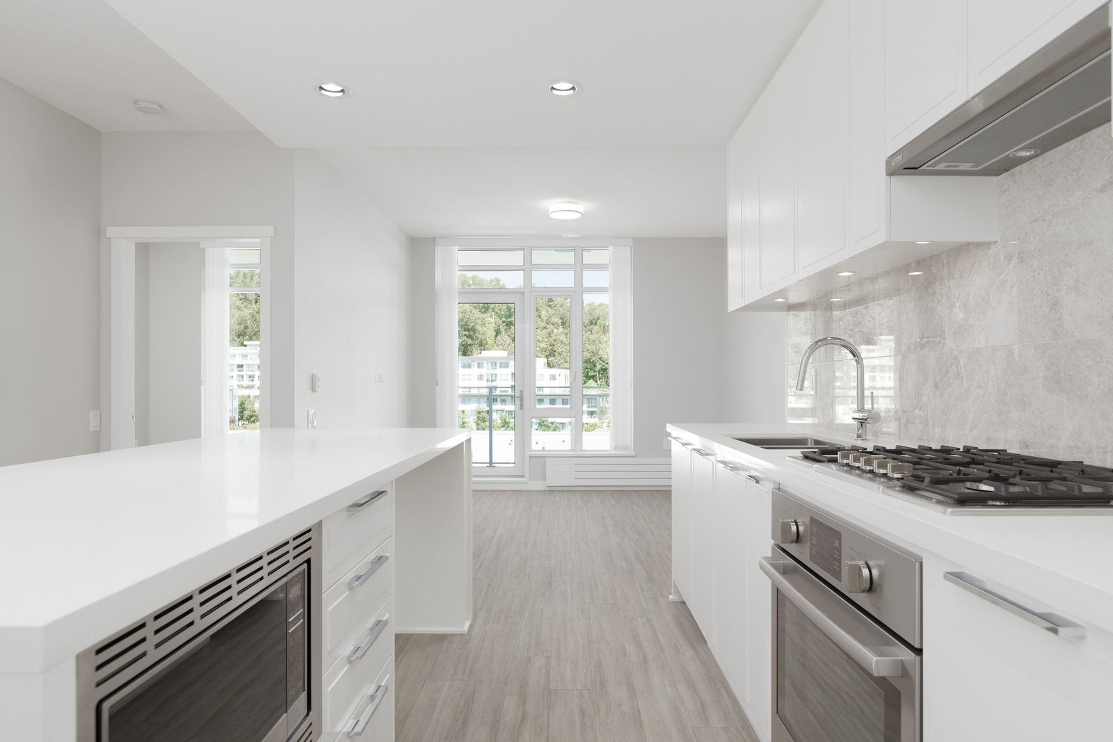 open concept layout that provides flow from the kitchen to the living area