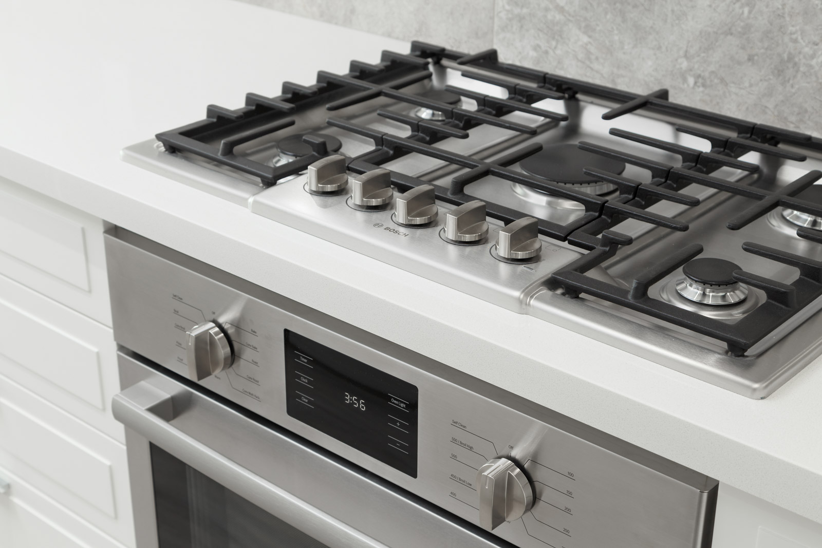 high end gas stove in kitchen in property located in River District