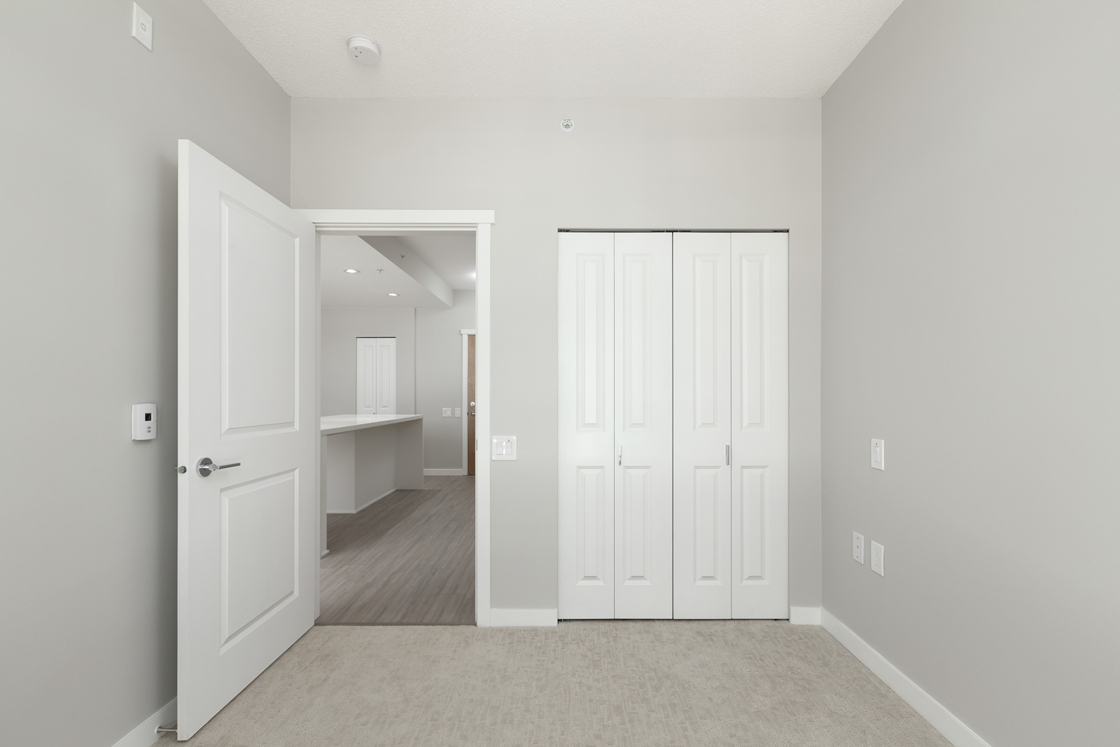 bedroom with closet in rental condo at Currents at Water's Edge in the River District neighbourhood of Vancouver