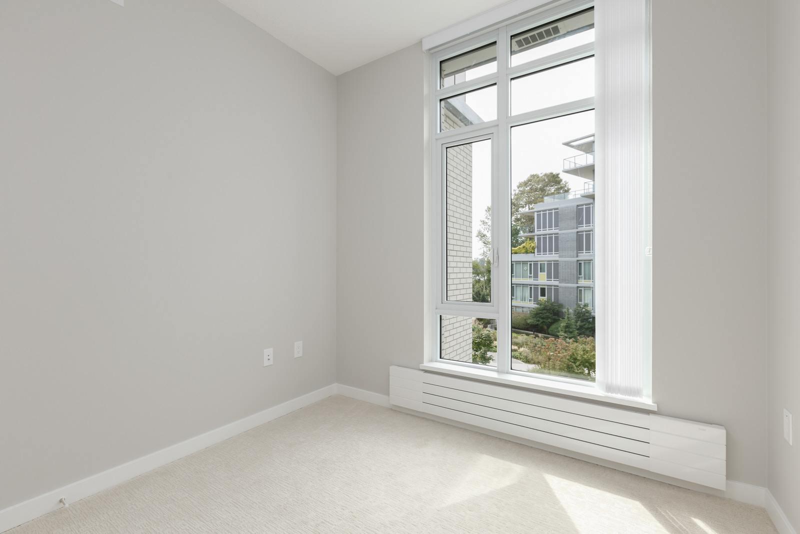 bedroom with large window that allows plenty of natural light to flow in