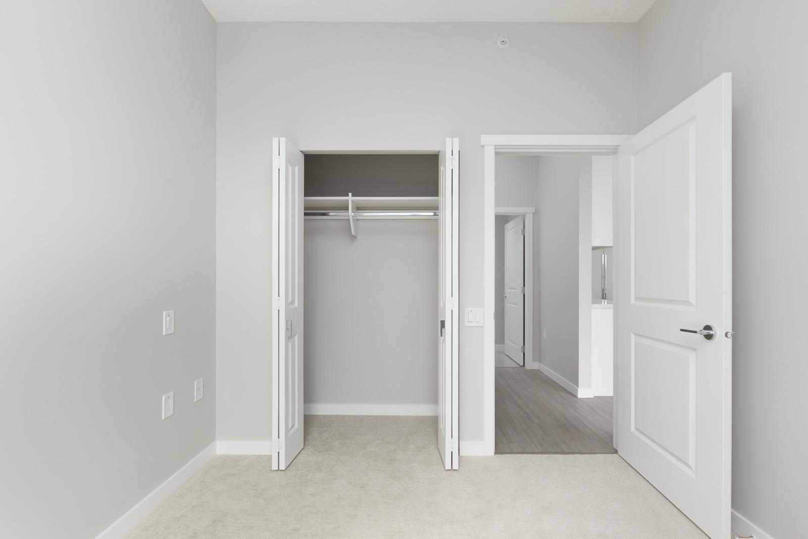 walk in closet in brand in suite managed by Birds Nest Properties