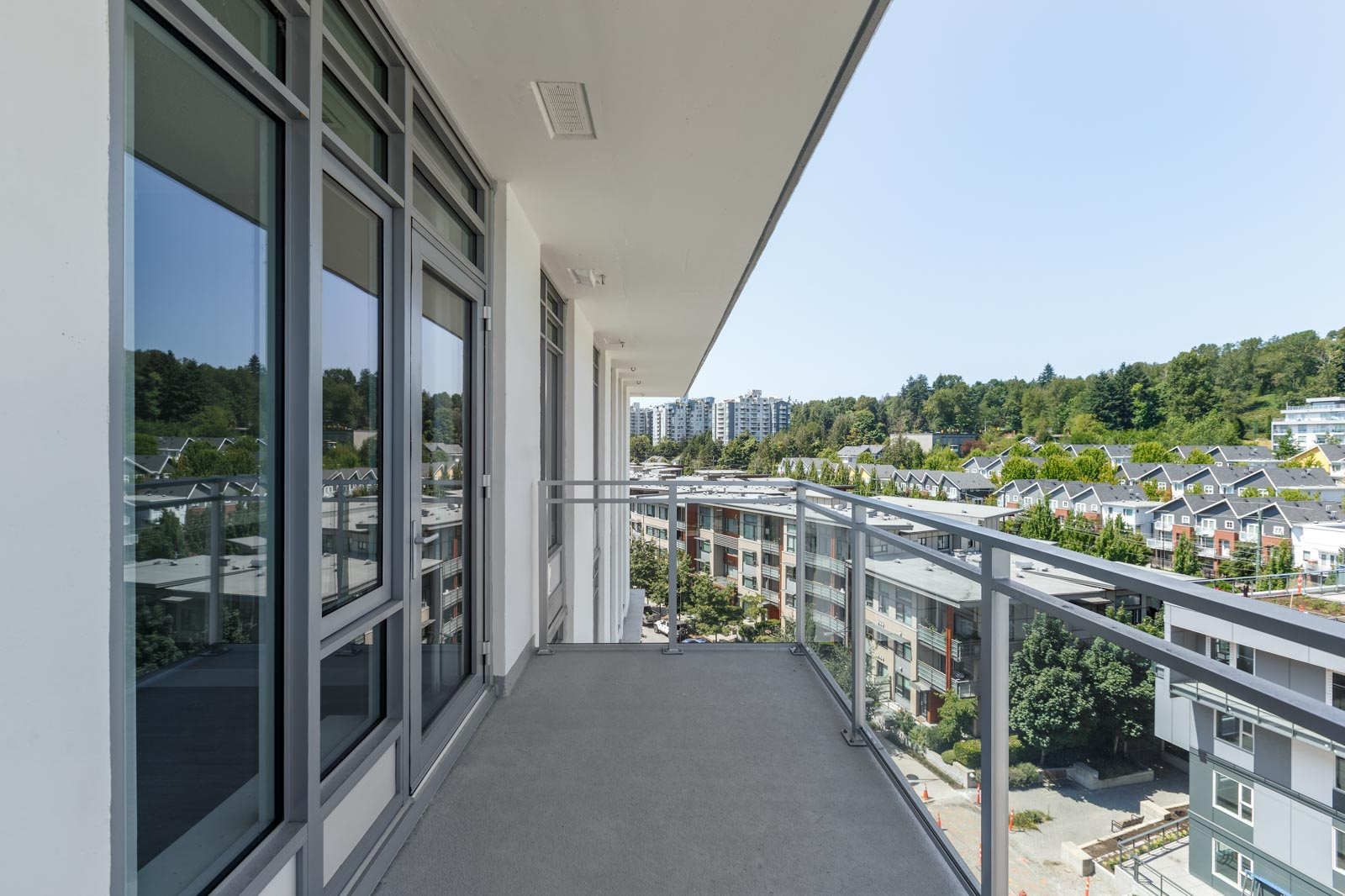balcony with view of clear skies in rental condo in the River District neighbourhood of Vancouver