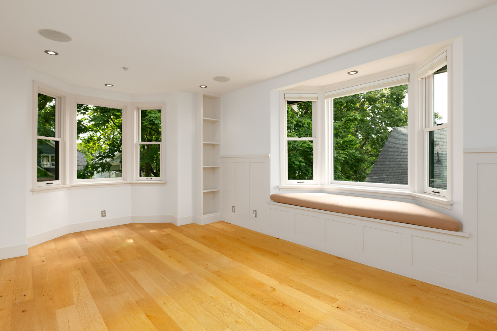 spacious living area with hardwood floor