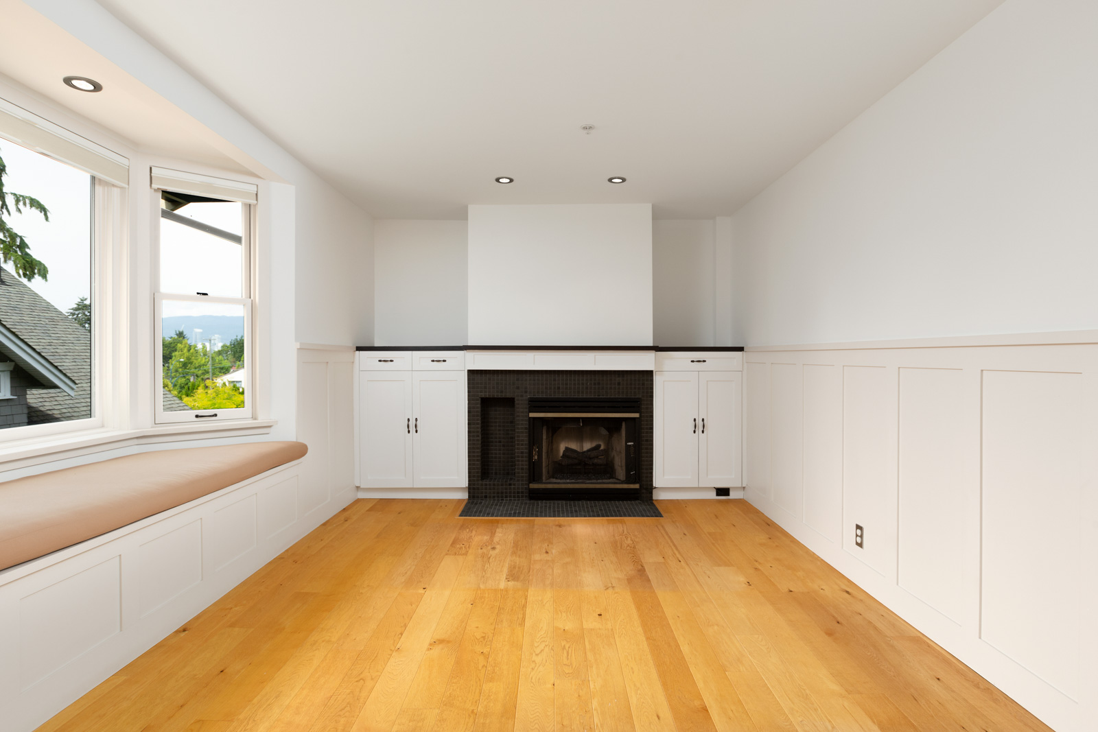 fireplace in second living room with hardwood flooring