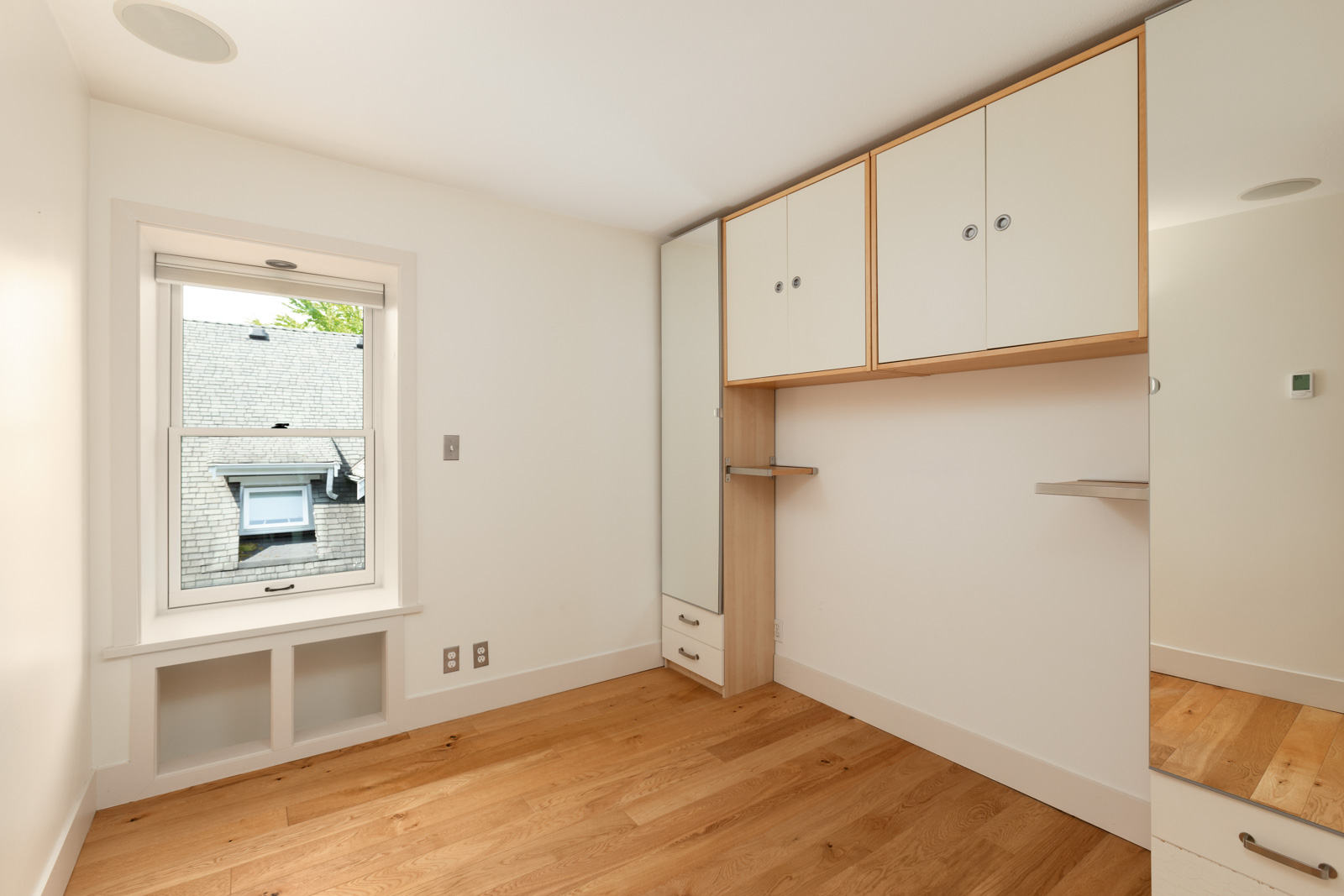 bedroom with plenty of storage cabinets