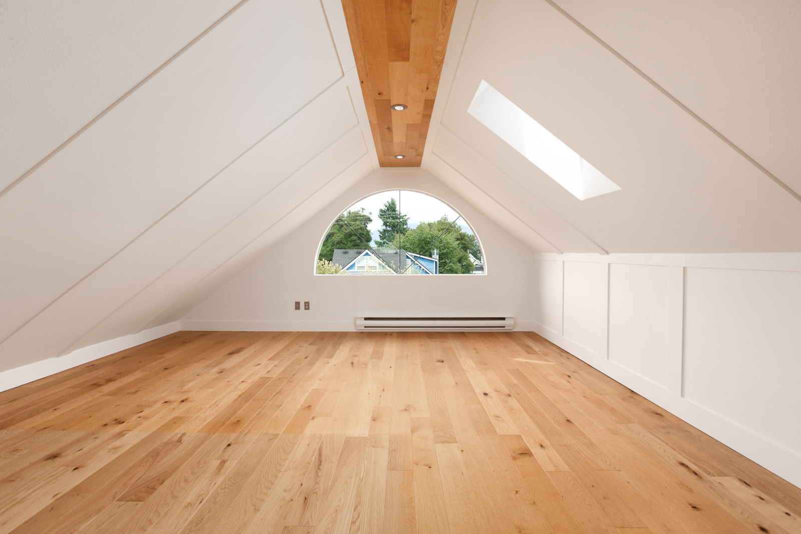 spacious bedroom with A-framesque roof