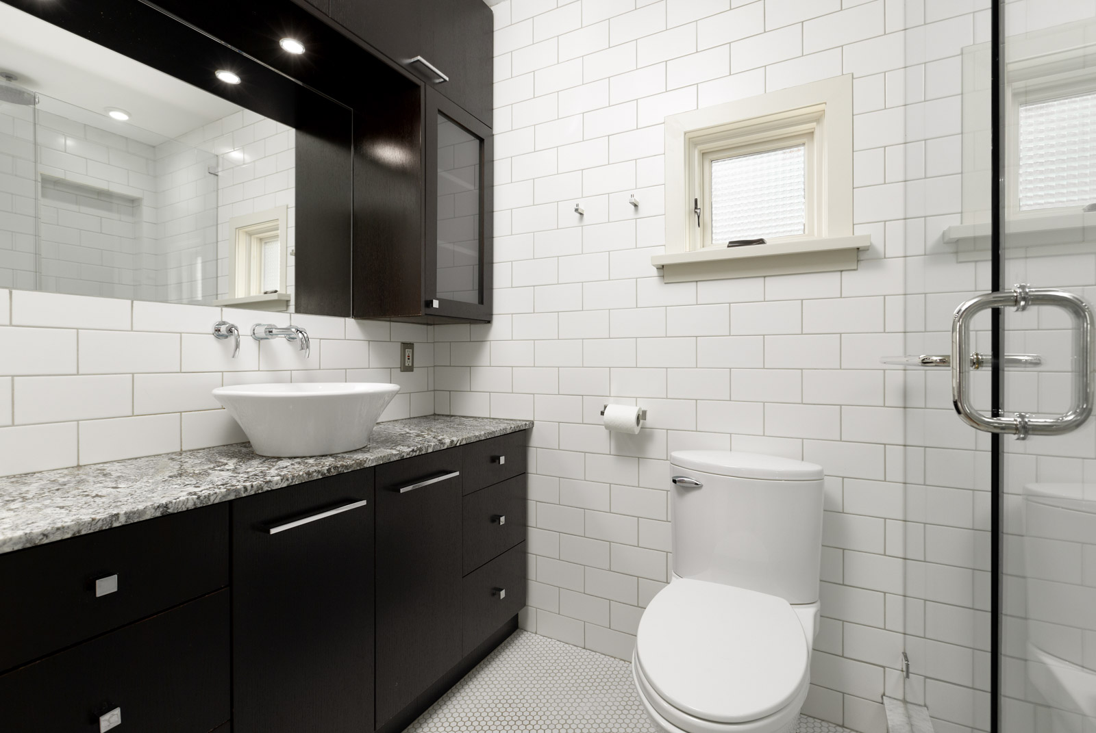 bathroom with textured wall and plenty of storage space
