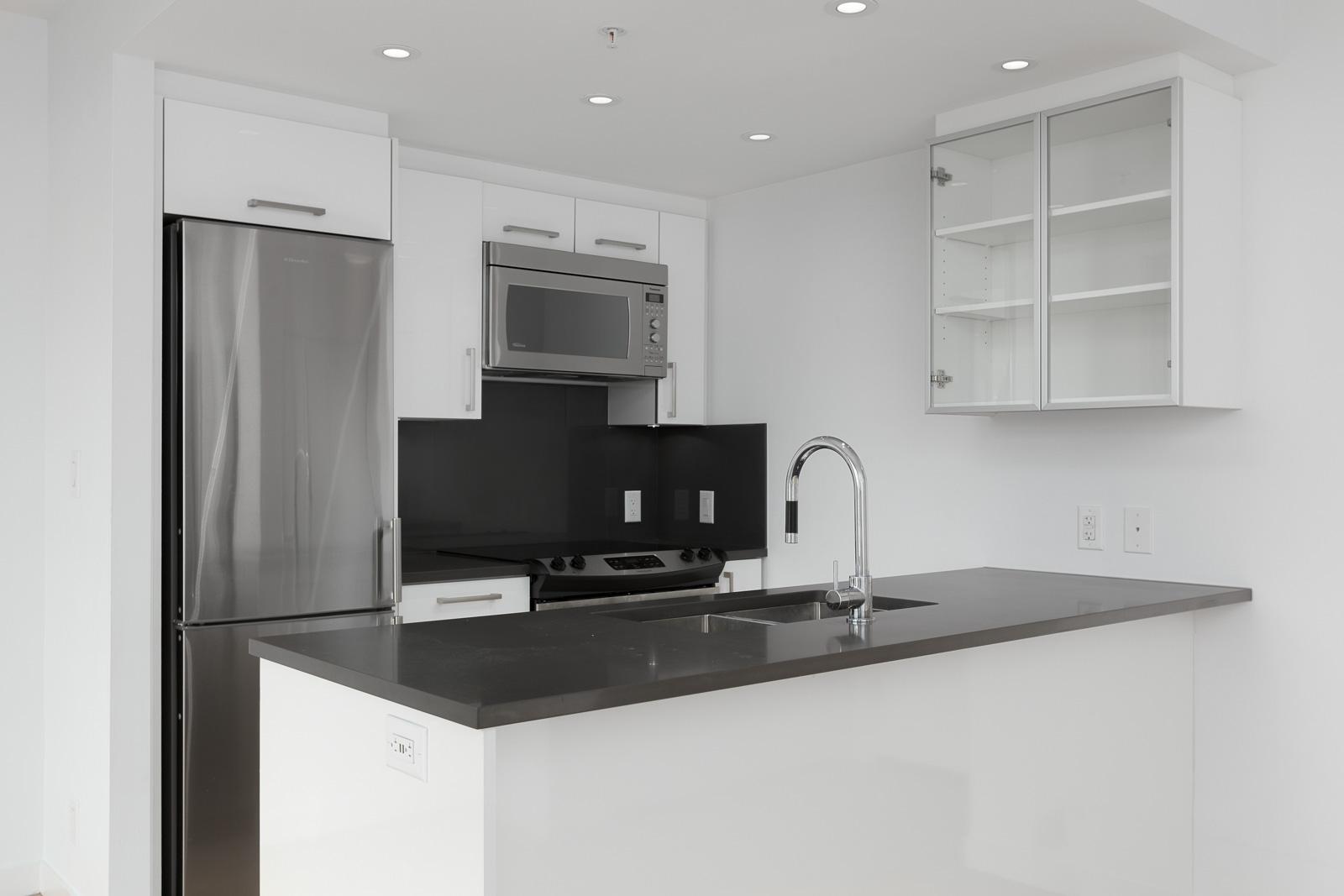 grey colour scheme with all the essential kitchen appliances
