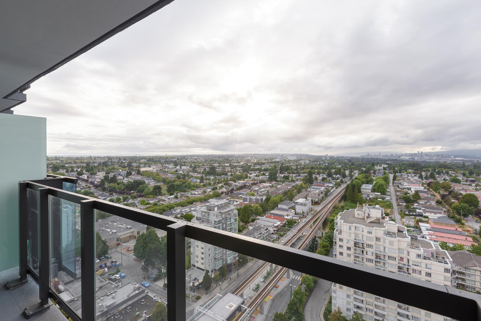balcony with view of clear skies in rental condo in the Joyce neighbourhood of Vancouver