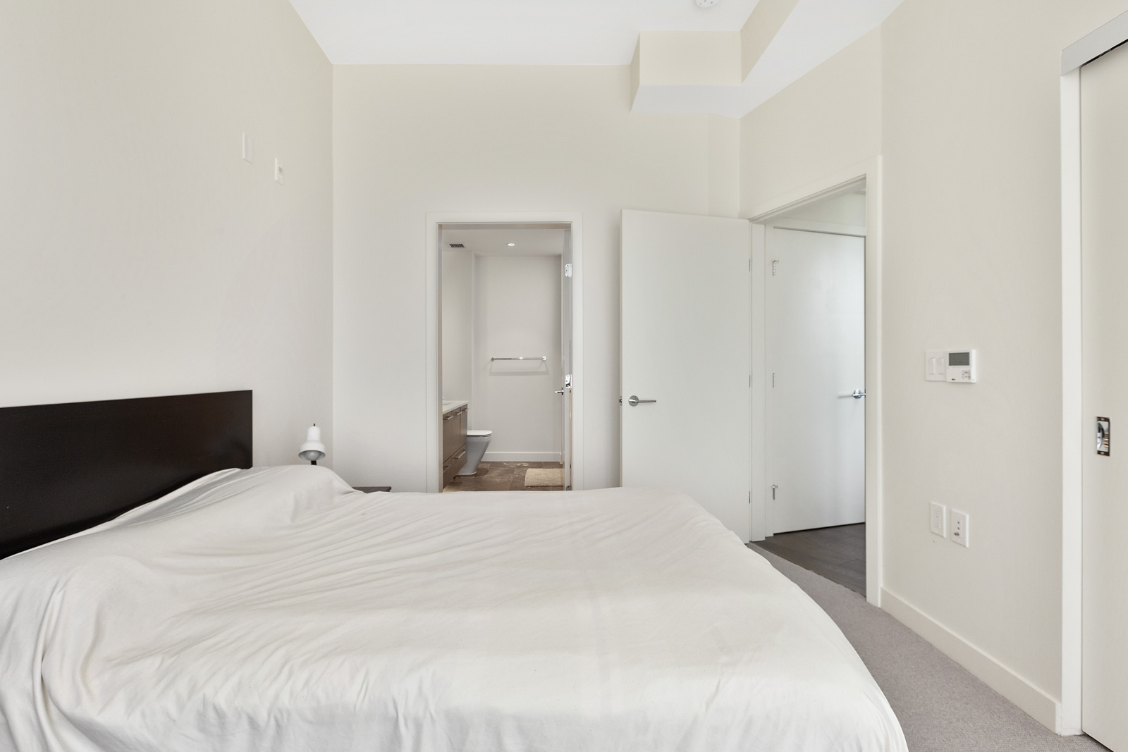 bedroom with walk in closet in property managed by birds nest properties