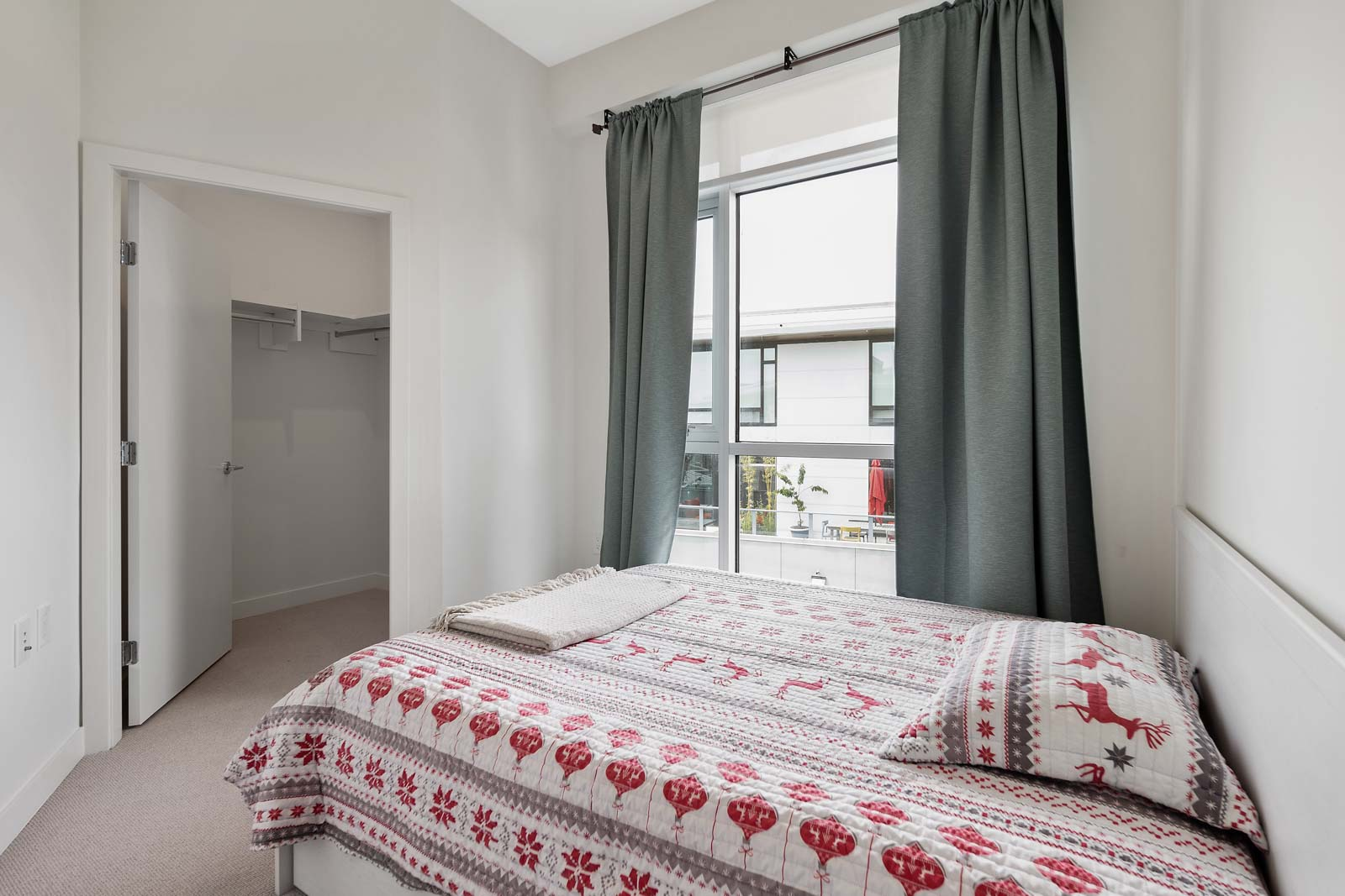 second bedroom with large windows that provides plenty of natural light flow through the unit