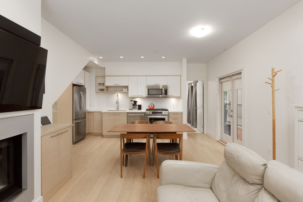 kitchen with wood table and chairs, and white kitchen cabinets