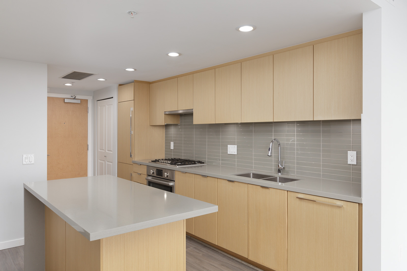 kitchen countertop with stove in background