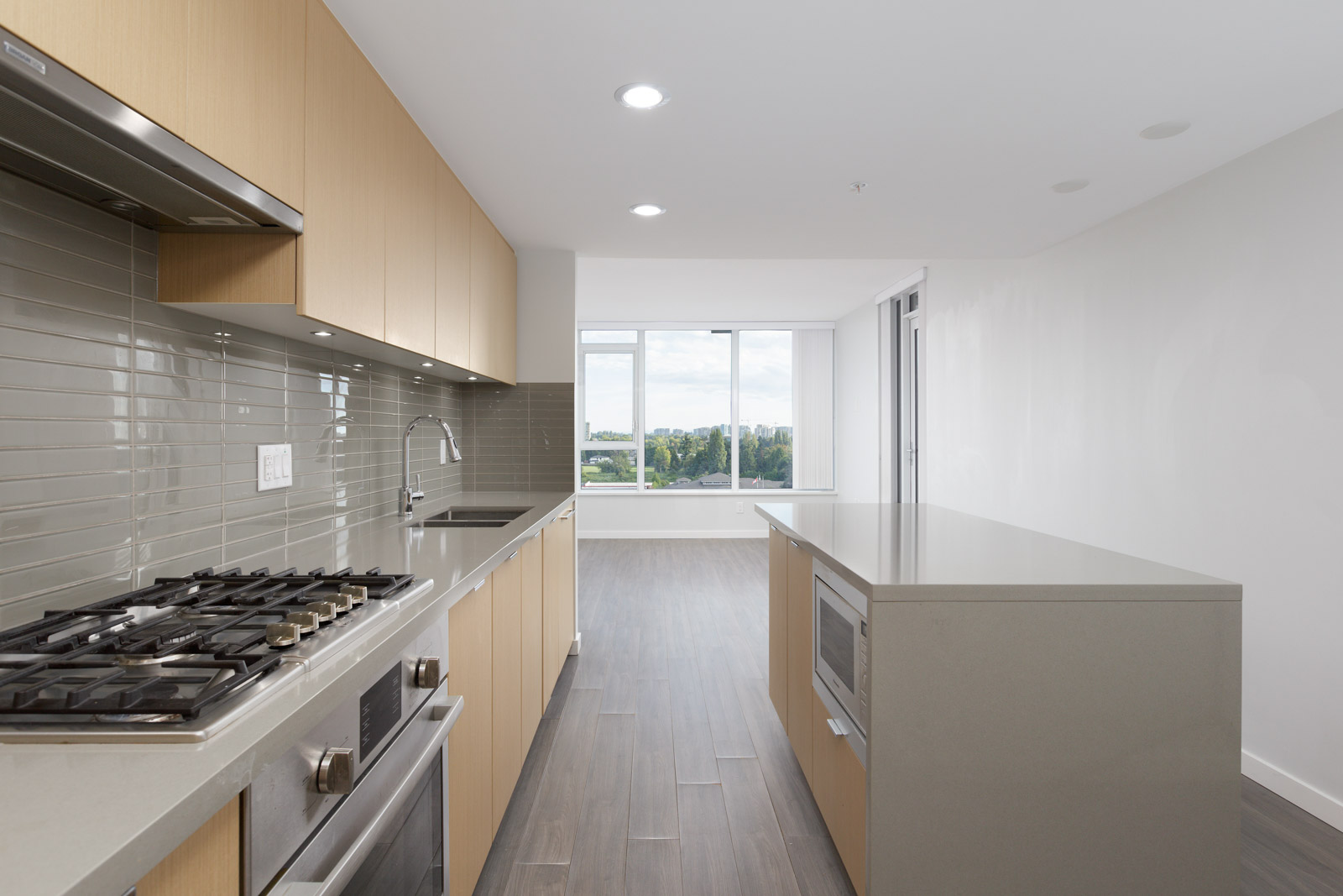 kitchen inside Richmond condo with living room in background